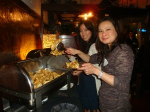 AAJA members help themselves to some dumplings at the Los Angeles chapter's Spring Mixer at FarBar.