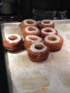 A tray of cronuts waits to be devoured.