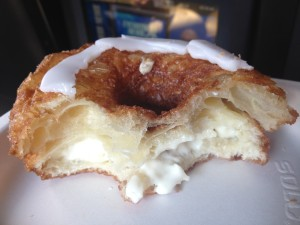 The inside of the cronut, with its flaky layers and cream filling.