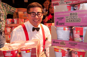 Craig Tomiyoshi, IW Group Team Captain, sits with the coveted year's supply of instant noodles, awarded to the first Spirit Award Winners.  (Photo credit: Michael Palma for AAJA-LA)
